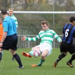 St Anthony's FC v Larkhall Thistle FC SJFA West Region Central District Division 1 14th November 2015  St Anthony's Midfielder Findlay McKenzie (6) loses his footing as he beats the Larkhall No 6 to the ball