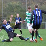 St Anthony's FC v Larkhall Thistle FC SJFA West Region Central District Division 1 14th November 2015  St Anthony's Midfielder Findlay McKenzie (6) tries to avoid the lunging challenge of the Larkhall midfielder