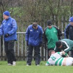 St Anthony's FC v Carluke Rovers FC, 9th January 2016  Looks like a bad one, St Anthony's Midfielder Findlay McKenzie's (8) game is over as St Anthony's Defender Thomas Miller (3) and St Anthony's Kit Man Paul Downie look on.
