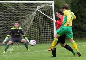 Newmains United CFC v St Anthony's FC, SJFA West Region, Central District, Division 2, 3 September 2016St Anthony's Forward Grant Kelly (21) gets a shot away bit the Newmains No3 gets a block in just i time!  Newmains United CFC v St Anthony's FC, SJFA West Region, Central District, Division 2, 3 September 2016, Victoria Park, Newmains, Scotland